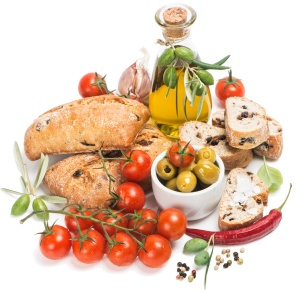 Fresh bread with olives, tomatoes, spices and olive oil